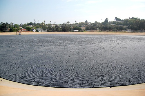 floating shade ball cover on a reservoir
